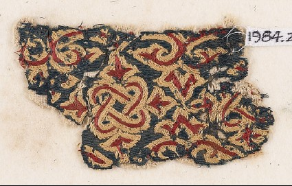 Textile fragment with knotted interlace, trefoils, and leavesfront