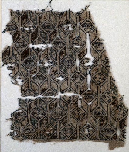 Textile fragment with linked diamond-shapes, hexagons, and pseudo-inscriptionfront