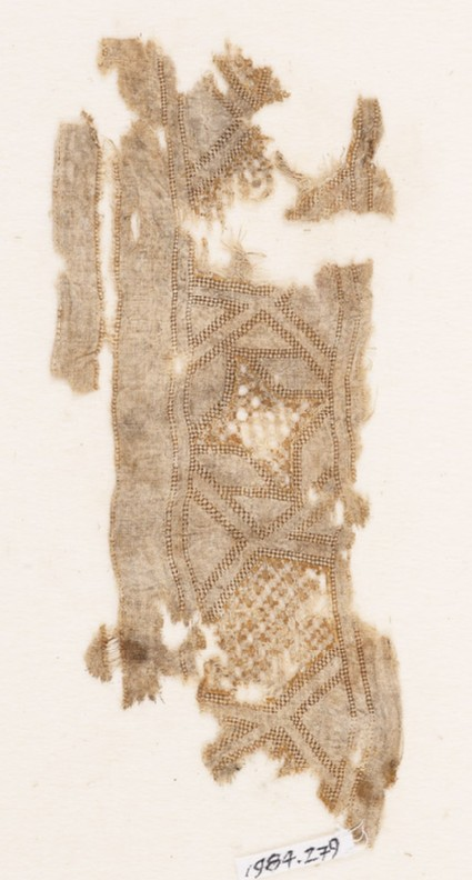 Textile fragment with stars and rhombic shapesfront