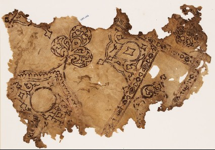 Textile fragment with remains of a large medallion with a trefoil finialfront