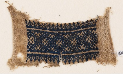 Textile fragment with band of diamond-shapes and linked crossesfront