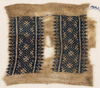 Textile fragment with diamond-shapes and crossesfront