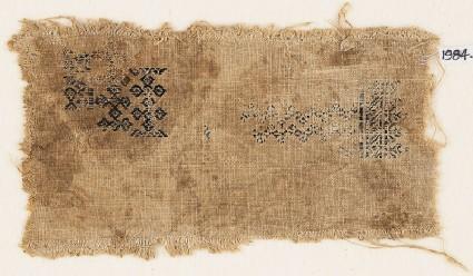 Textile fragment with linked quatrefoils and chevronsfront