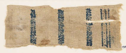 Textile fragment with zigzags and linked squaresfront