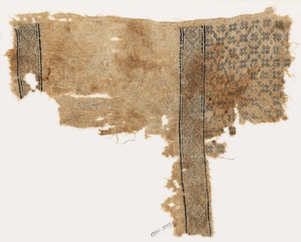 Textile fragment with flowers, crosses, and interlacing diamond-shapesfront