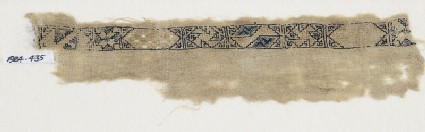 Textile fragment with band of cartouches, spirals, and starsfront