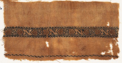 Textile fragment with band of Z-shapes and squaresfront