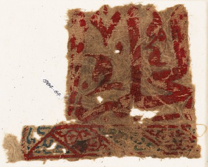 Textile fragment with inscription and arabesque tendrils, possibly from a wall hangingfront