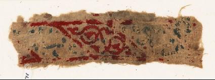 Textile fragment with lozenges, arabesque, and inscriptionfront