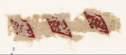 Textile fragment with lozenges and inscriptionfront