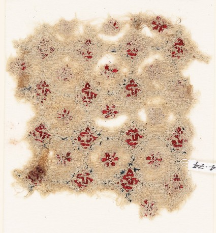Textile fragment with rosettes, linked circles or hexagons, and inscriptionfront