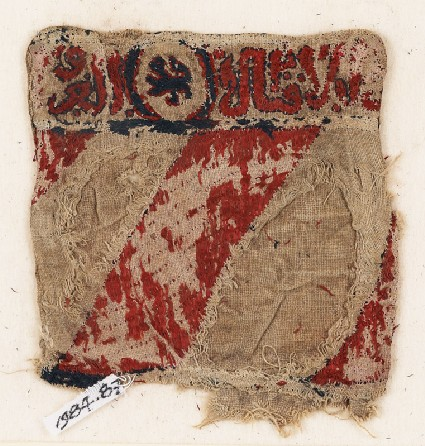 Textile fragment with lion and inscription, possibly from a bag or pocketfront