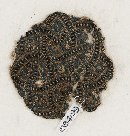 Roundel textile fragment with interlacefront