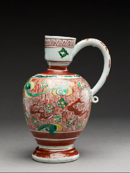 Jug with flowers and plants among cloudsside