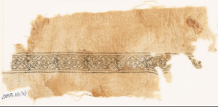 Textile fragment with band of interlacing and four-leaved tendrilsfront