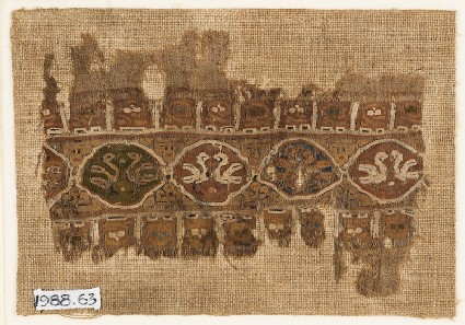 Textile fragment with linked medallions and birdsfront