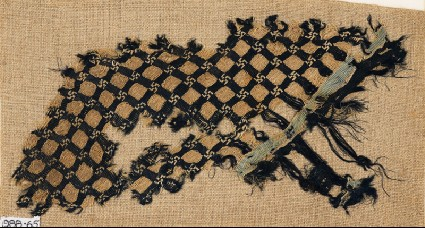 Textile fragment with grid and swastikasfront