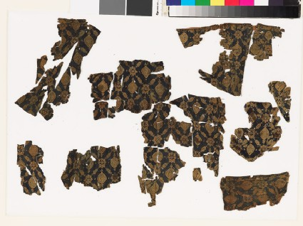 Group of textile fragments with medallions and starsfront