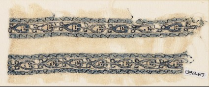 Textile fragment with bands of linked leaves or palmettesfront