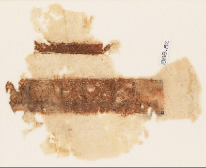 Textile fragment with band of kufic inscription and vine with tendrilsfront