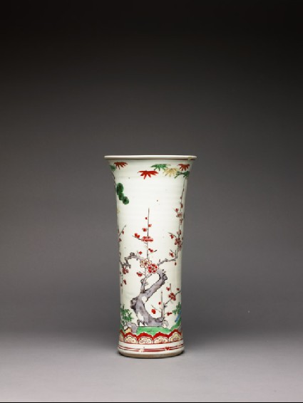 Trumpet vase with pine, prunus, and bambooside