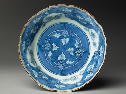 Bowl with foliated rim and floral scrollstop
