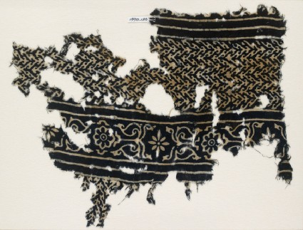 Textile fragment with linked chevrons and flowers, possibly from a garmentfront