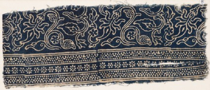Textile fragment with stems, leaves, and blossomsfront