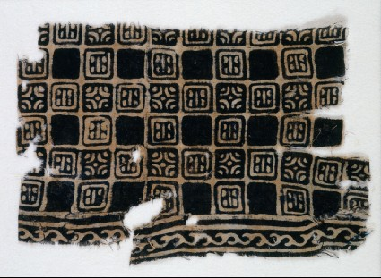 Textile fragment with linked squares, stylized flower-heads, and lines with dotsfront