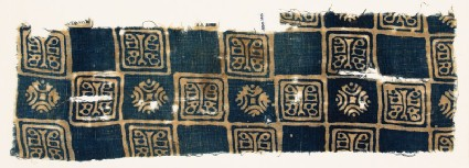Textile fragment with linked squares, stylized animals, and stylized flowersfront
