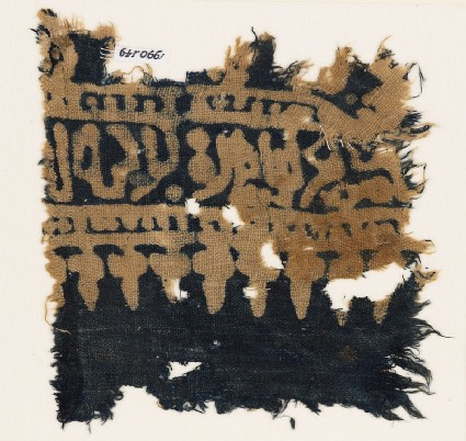 Textile fragment with Arabic-style script, dots, and stylized leaves or treesfront