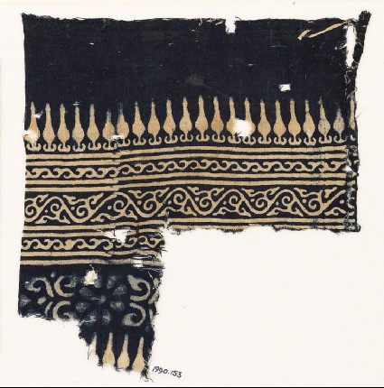 Textile fragment with stylized bodhi leaves, vines, and a rosettefront