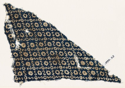 Textile fragment with S-shapes, circles, and starsfront