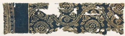 Textile fragment with lotus vines, medallions, rosettes, and inscriptionfront