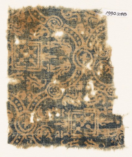 Textile fragment with linked medallions, stylized leaves, and squaresfront