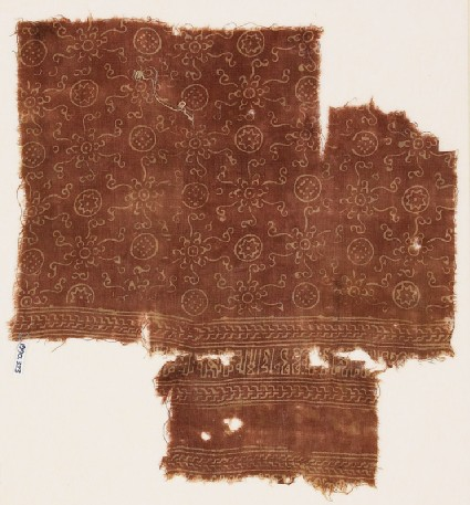Textile fragment with circles, flowers, rosettes, and kufic-style scriptfront