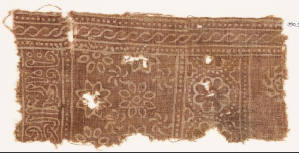 Textile fragment with rosettes and inscriptionfront