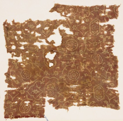 Textile fragment with tendrils and rosettesfront