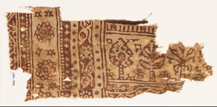 Textile fragment with stylized trees and three-layered rosettesfront