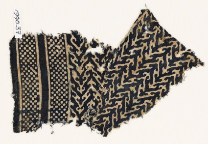 Textile fragment with linked chevrons, trefoils, and bands of dotsfront