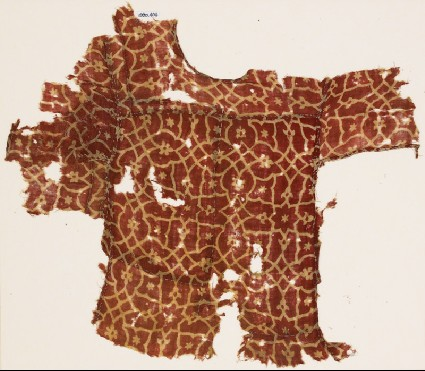Textile fragment from a child's tunic, with interlacing tendrils and flowersfront