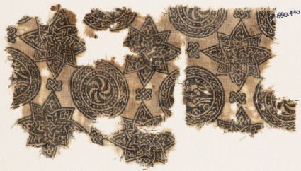 Textile fragment with spirals in braided circles, and starsfront