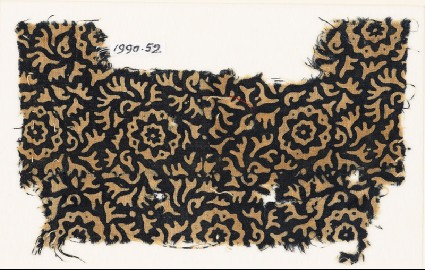 Textile fragment with swirling leaves and flowersfront