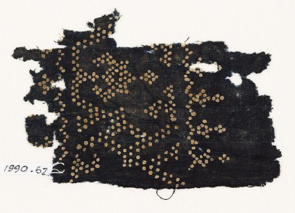Textile fragment with dots arranged as a band, possibly with a vase shapefront