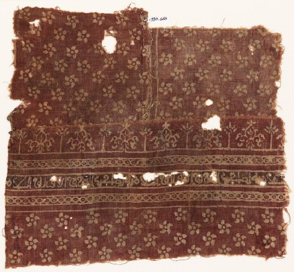 Textile fragment with flowers, cable pattern, stylized plants, and Arabic inscriptionfront