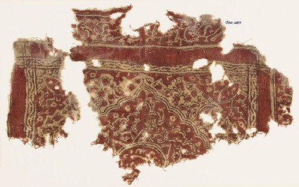 Textile fragment with medallion, floral patterns, and Persian-style scriptfront