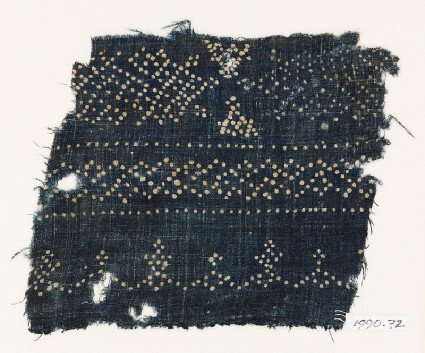 Textile fragment with dots arranged in geometric patternsfront