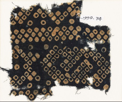 Textile fragment imitating bandhani, or tie-dye, with inverted hooksfront