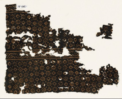 Two textile fragments with rosettes, lobed squares, and dotsfront
