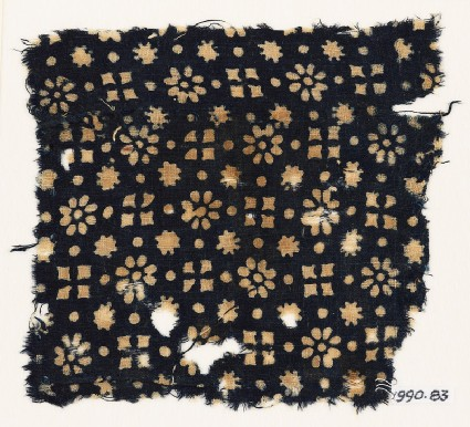 Textile fragment with rosettes, dots, floral shapes, and squaresfront